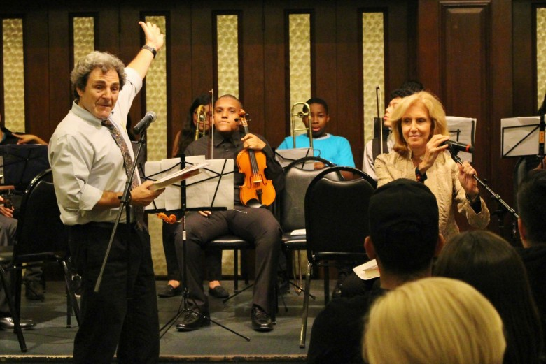 Tricia Tunstall and Eric Booth discuss their new book while students from local El Sistema-inspired programs prepare to perform.